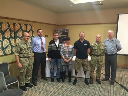 Simon Brown, Blind Veterans UK beneficiary and speaker at the GP training, second from left, along with speakers from other military organisations.  Lieutenant Colonel Julian Woodhouse, left and Dr Rob Stokes Acting Head of Health Education  England North West, far right