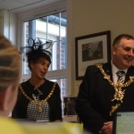 Lady Mayoress Leza Tremorin and Lord Mayor of Portsmouth Cllr David Fuller listen to charity staff