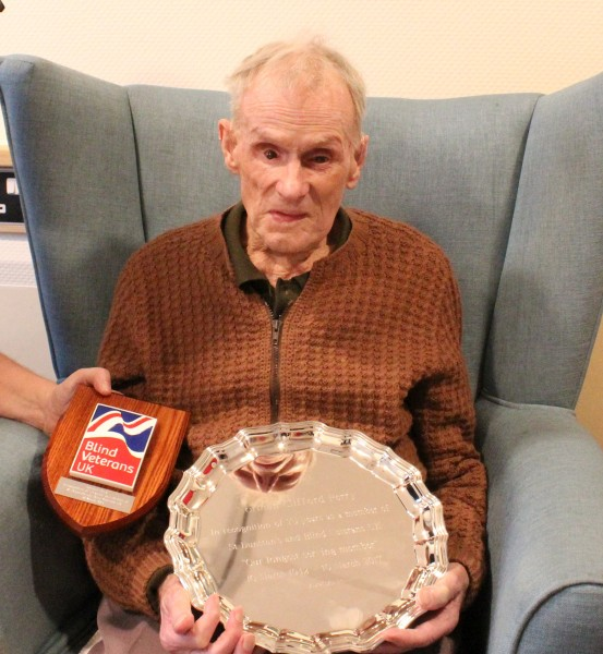 Norman Perry with his plaque and silver salver
