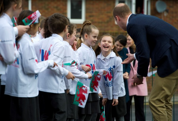 The Duke of Cambridge greets pupils at Llanfoist Fawr Primary School in Wales on St David's Day at the launch of the SkillForce Prince William Award today.