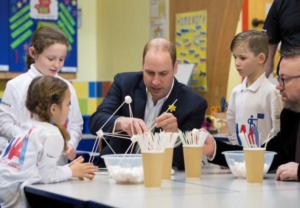 The Duke of Cambridge helps to build a freestanding tower from marshmallows and straws, in the tower build challenge at the launch of the SkillForce Prince William Award today.