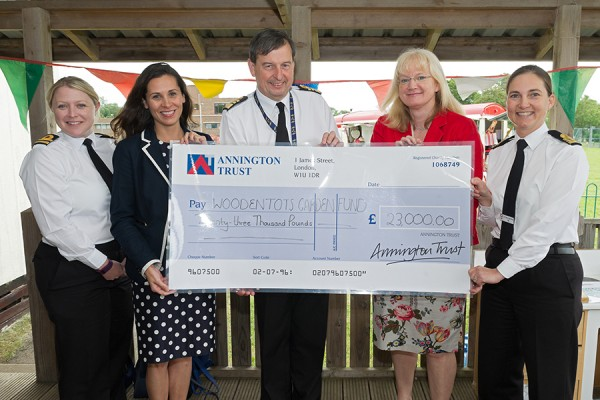 Vice Admiral Jonathan Woodcock OBE, the Second Sea Lord and Deputy Chief of Naval Staff and Anna Wright, Director, NFF receiving a cheque on behalf of Woodentots Nursery from Annington's Vanessa Farnell