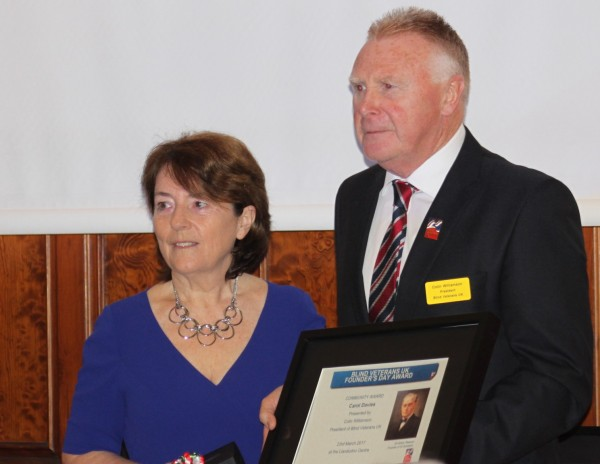 Carol Davies recieving her Founder%27s Day Award from Blind Veterans UK President Colin Willimason