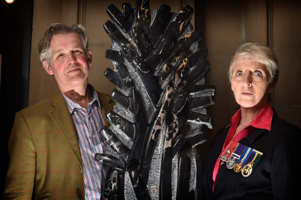 Photo Caption - Lieutenant Colonel Helen Homewood and sculptor Simon Burns-Cox with 'France 1914' at the Kelvingrove Art Gallery today.
