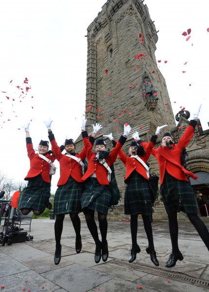 Irena Watson 12, Millie MacDonald 13, mirren wood 12 Simoon Pun 13, and Tiana Robbins 13 from Queen Victoria School Dunblane at the Wallace Monument today as 4600 petals from from the Crown.