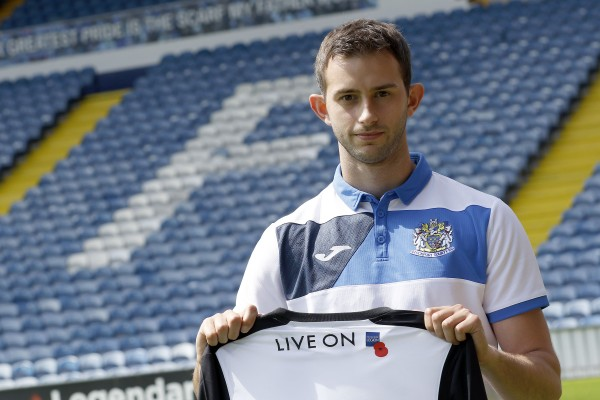 County striker Adam Thomas with the new shirt at Edgeley Park