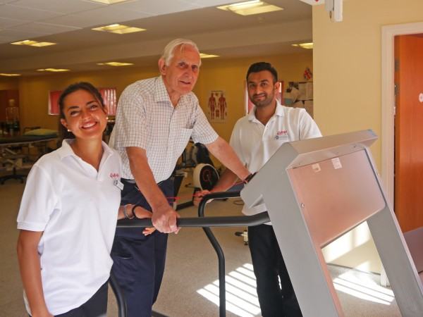 Ex-Serviceman, Hadley Norris, with QAHH Physiotherapists, Camilla Castellini and Karan Dhanak