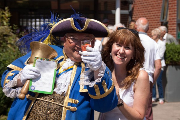 Worthing Town Crier, Bob Smytherman, with QAHH Head of Fundraising, Elizabeth Baxter (Credit: John Young Photography)