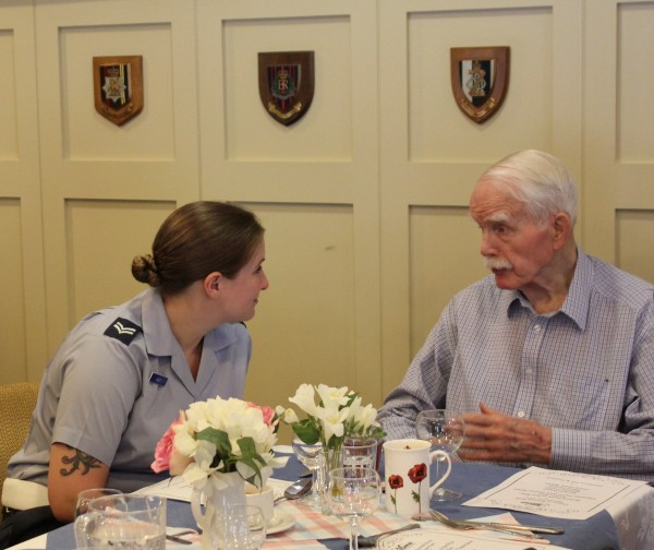 RAF Veteran Iain chatting over lunch with Corporal Way