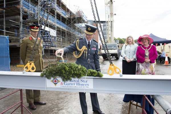 Major General Tim Tyler, Air Chief Marshal Sir Stephen Hillier, Lady Hillier and Councillor Suzanne Brown at the topping out ceremony of The Royal Star & Garter Home – High Wycombe.