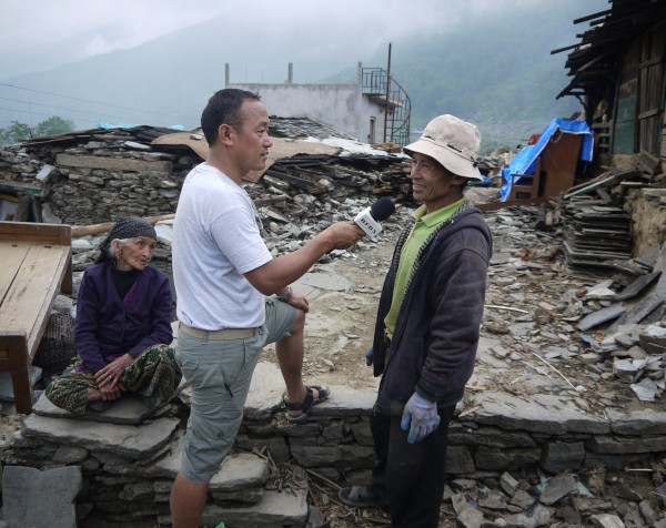 2. Principal Programmer (Brunei) Yograj Rai reporting in remote areas of Nepal after the 2015 earthquakes