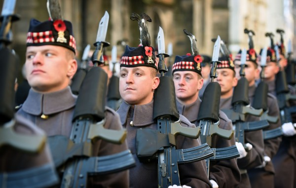 Soldiers from The Royal Regiment of Scotland wear poppies in their head-dress as a mark or respect on Edinburgh's Remembrance Sunday.