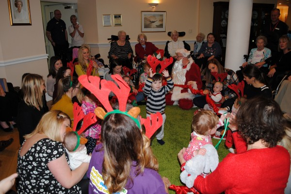 Residents and children join together in a festive sing-along
