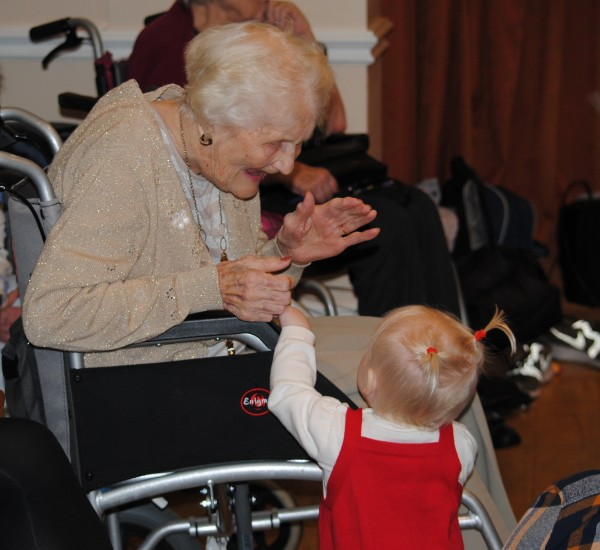 Resident, Vera, sharing a heart-warming moment with toddler