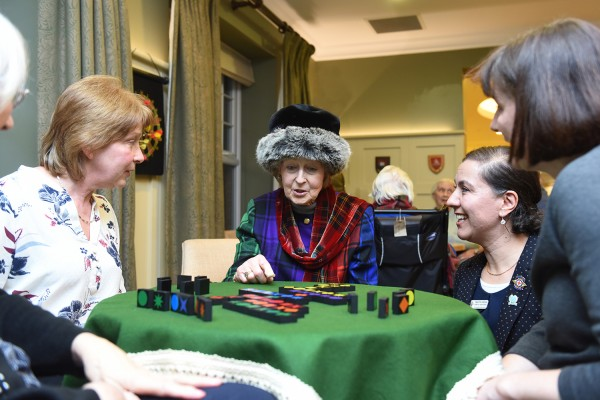 •Her Royal Highness Princess Alexandra chatting with residents and staff over a game of Qwirkle