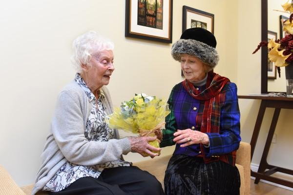 Her Royal Highness Princess Alexandra receiving a posy from WAAF veteran Phyllis