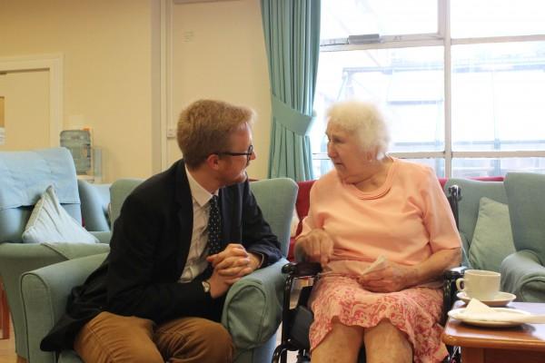Lloyd Russell-Moyle speaking with blind veteran Fay Longman