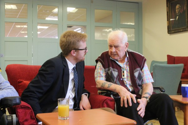Lloyd Russell-Moyle speaking with blind veteran Fred Tree