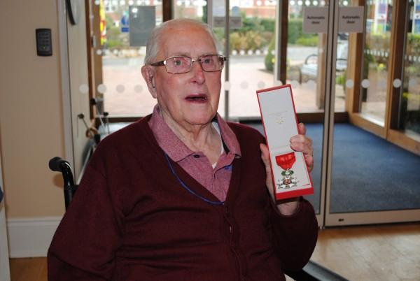 Arthur proudly holding his Legion d'honneur medal