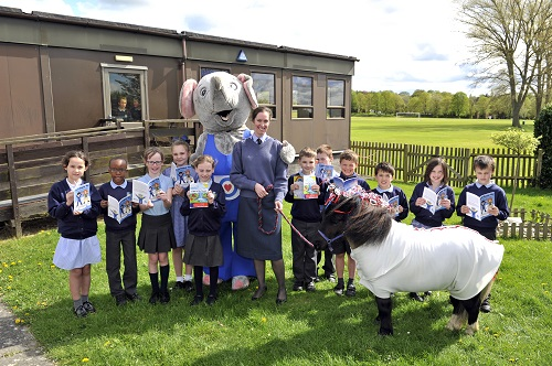 Children meet Ben Elephant and Raphael the unicorn at the launch with OC Base Support Wing, Wing Commander Toria McPhaden
