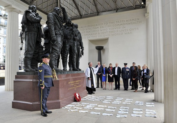 53 pairs of flying gloves pay tribute to the 53 men who made the ultimate sacrifice 75 years ago on the Dambusters raid. This moment of reflection was staged at London's Bomber Command Memorial, hosted by the Memorial's guardian and leading RAF welfare charity, the RAF Benevolent Fund Tomorrow a gala screening of The Dam Busters film will be live at the Royal Albert Hall and simulcast throughout cinemas competed by historian Dan Snow who will conduct a 'bouncing bomb experiment' on stage and speak to relatives of those who took part. Tickets rafbf.org/dambusters . Pictured is Flight Lieutenant Nigel Painter who joined the service and tribute today. This photo may only be used in for editorial reporting purposes for the contemporaneous illustration of events, things or the people in the image or facts mentioned in the caption. Re-use of the picture may require further permission from the copyright holder. Photo credit should read: Adrian Brooks/Imagewise