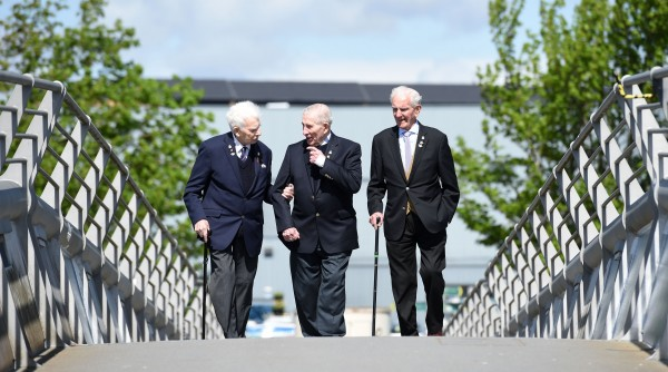 VETERANS TO RETURN TO WORLD WAR TWO SCENE OF ARCTIC CONVOYS Three veterans in their nineties will travel to Wester Ross tomorrow to attend a special annual ceremony to commemorate the Russian Arctic Convoys of the Second World War; an event that claimed 3,000 lives. The trio, who are making the trip thanks to the Unforgotten Forces project which supports older veterans and their families in Scotland, have become close friends and will also enjoy a three-night stay at a hotel in Gairloch as part of a new ÒBreak AwayÓ service. Germany invaded the Soviet Union in June 1941, which brought the Western Allies together to provide essential support and supplies to the Soviet forces. Chosen for its remote and isolated location, Loch Ewe, in the northwest Highlands, was the gathering point for many of the Arctic Convoys before they embarked on their perilous journey. The most direct route was by sea, around northern Norway to the Soviet ports of Murmansk and Archangel. Between August 1941 and 1945, a total of 78 convoys travelled to and from northern Russia, taking four million tonnes of supplies to the Soviet forces, including 7,000 planes and 5,000 tanks. Tragically, more than 3,000 sailors and merchant seamen lost their lives on the convoys. Sharon Higgins, Deputy Head of Welfare Services at Poppyscotland, said: ÒThe route taken by the convoys was exceptionally dangerous, especially in winter, and conditions were among the worst faced by any Allied sailors during World War Two. In addition to battling the elements, many of the convoys were attacked by German submarines, aircraft and warships. ÒNo-one can underestimate the role played by the thousands of brave sailors who embarked on these perilous but pivotal missions. Now, more than 75 years on, Poppyscotland is delighted to be leading the Unforgotten Forces consortium as well as delivering the Break Away service in partnership with The Travel Company Edinburgh. Collaboration is at the heart of what we do, and the veteran