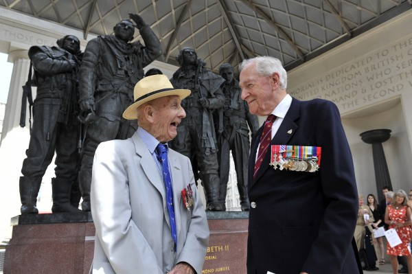 Right, veterans Warrant Officer Cecil 'Chick' Chandler and Wg Cdr John Bell chat after the service