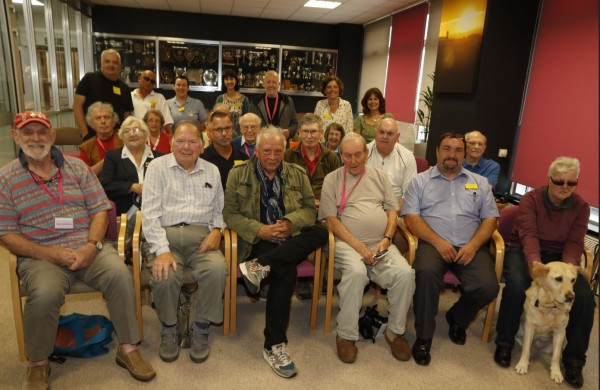 Note on image above: Nick Barber (second row, second from right) with veterans supported by Blind Veterans UK and David Bailey (front centre). Image credit: Mark Pile
