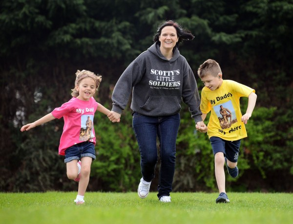 Nikki Scott of Scotty's Little Soldiers, with her children Kai and Brooke, who are running the Mini Gear 2014, in memory of their dad Cpl Lee Scott. Picture: Matthew Usher.