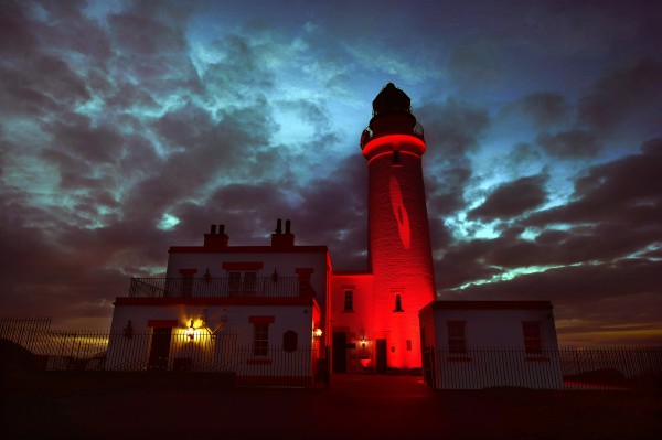 © Sandy young Photography 07970 268944 The Halfway House, Turnberry Lighthouse lit up red with a poppy for Remembrance Day E: sandy@scottishphotographer.com W: www.scottishphotographer.com