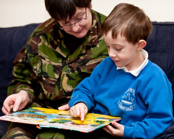 14/01/2011 - Aldershot, Hampshire. Stock photography to provide images for Reading Force initiative supported by the Commander 145 Bde and Kingston University. The project is a joint venture and is headed by Mrs Baverstock, wife of the brigade Commander, 145 Brigade and intends to encourage Army families to encourage reading amongst their children and other service families. The Reading Force initiative is support by several schools in the Aldershot area and the program should go live in April 2011. Central to the idea is the formation of local book reading groups which will discuss the books they have read and complete scrapbooks about the books. The images will be used in advertising material from the scheme. NB: Model release forms held for all children and adults involved in the photoshoot. Seen here; Joshua Harrison and his mum, Major Rebecca Harrison, ETS, read a pirate book for the Aldershot led Reading Force initative.